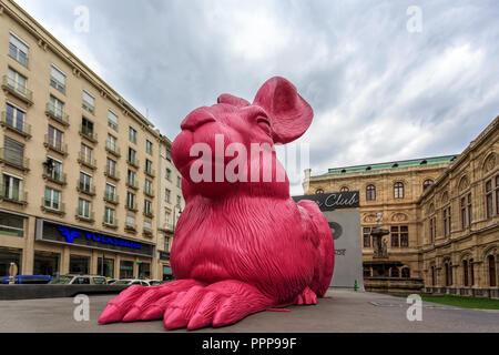 VIENNA, AUSTRIA - JUNE 27, 2015: Pink bunny sculpture near State Opera in Vienna. Made by the German concept artist Ottmar Horl - Stock Photo