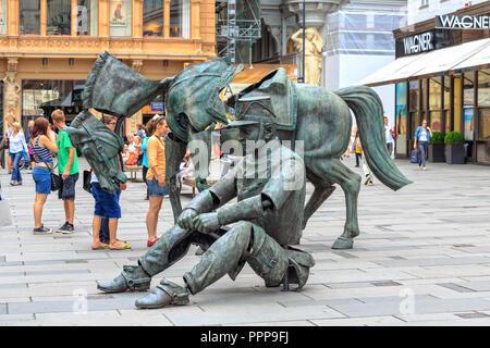 VIENNA, AUSTRIA - JUNE 27, 2015: Sculpture of the french artist Julien Berthier at Graben street in Vienna, Austria - Stock Photo