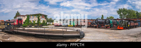 Jaworzyna Slaska, Poland - August 2018 : Panoramic view of the old disused retro train locomotives and carriages on the side tracks in the depot in th - Stock Photo