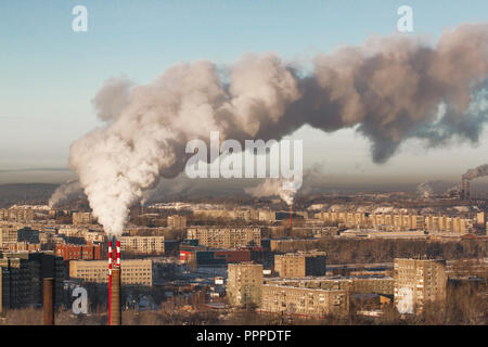 Poor environment in the city. Environmental disaster. Harmful emissions into the environment. Smoke and smog. Pollution of the atmosphere by plants. E - Stock Photo