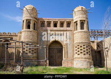 Old castle in Eastern Kazakhstan. Fortress the nomads. Walls and gate of the old fortress made of stone and lined with patterned tiles. Battle towers  - Stock Photo