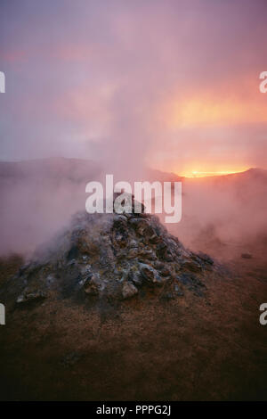 The geothermal area of Namafjall / Hverir near Lake Myvatn at dusk in northern Iceland. - Stock Photo