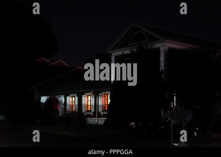 The light in the Windows of a country house. Night, summer, village - Stock Photo