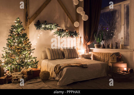warm and cozy evening in living room. Sofa bed In christmas Interior. concept the new year and holidays. - Stock Photo