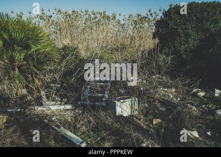 Garbage in the national park in Sardinia - Stock Photo