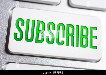 Macro Of The Word Subscribe On A Keyboard Button - Stock Photo