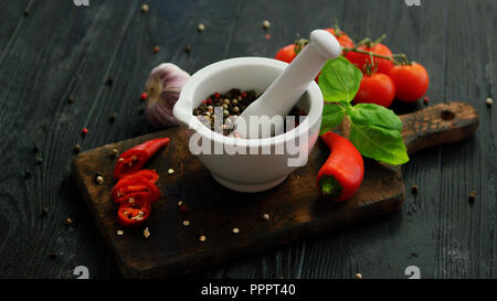 Bowl with spices on wooden cutting board - Stock Photo