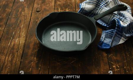 Cast iron pan on table - Stock Photo
