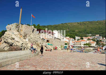 Small boat harbor with tourists and sightseeing boats in Petrovac, Montenegro, Europe.  Horizontal photo with copy space. - Stock Photo