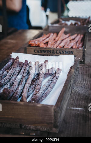London, UK - September 17, 2018: Gourmet salami and sausages at Cannon & Cannon market stall in Borough Market, one of the largest and oldest food mar - Stock Photo