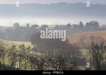 The medieval hill town of Macerata in Italy near the Sibillini mountains and the Adriatic Sea with a misty valley below taken from Montecassiano - Stock Photo