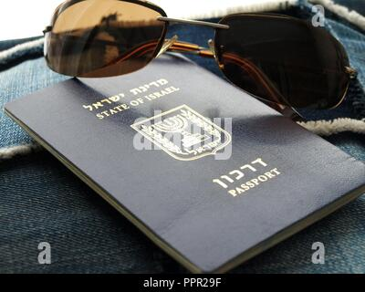 Israel Travel Passport - Darkon israeli with sunglasses on denim - Stock Photo