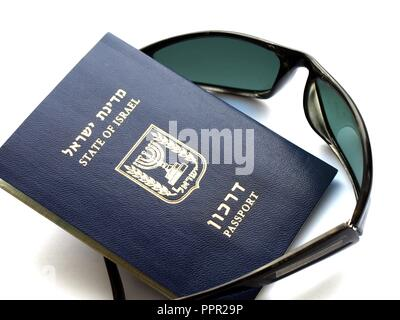 Foreign passport of Israel 'Darkon' and black sunglasses on white - Stock Photo