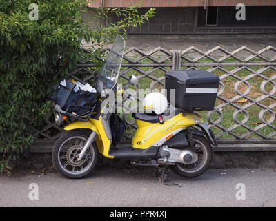 TURIN, ITALY - CIRCA SEPTEMBER 2018: Poste Italiane mail delivery motor bike - Stock Photo