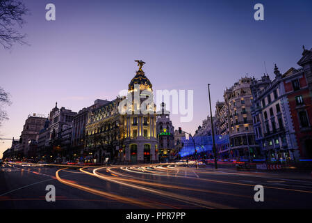Madrid, Spain - January 6, 2017: Night view of Madrid's Alcala and Gran Via streets illuminated by the traffic and Christmas lights. - Stock Photo