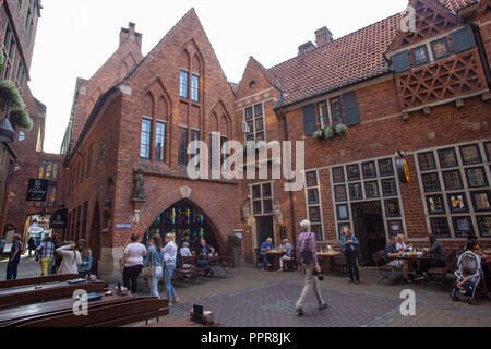 Cafe and restaurant in red brick buildings in Bremen famous tourism destination Boettcherstrasse  - Germany - Stock Photo