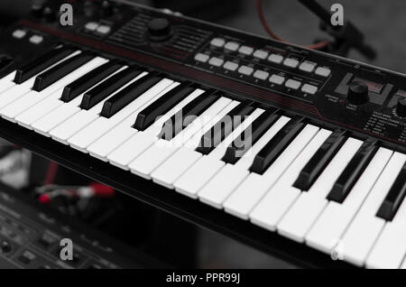 Synthesizer piano key board top view.Professional electronic midi keyboard with black and white keys. - Stock Photo
