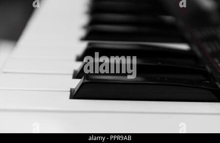 Synthesizer piano key board side view.Professional electronic midi keyboard with black and white keys. - Stock Photo