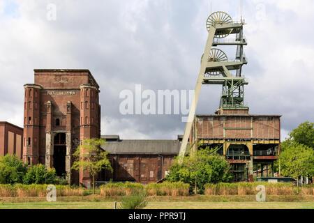 Zeche Ewald, industrial buildings and the former coal mine shaft tower, Herten, Ruhrgebiet, Germany - Stock Photo
