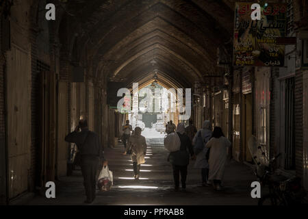 ISFAHAN, IRAN - AUGUST 8, 2018: Street of the Isfahan bazar in the evening in a covered alley of the market. Symbol of the Persian architecture, it's  - Stock Photo