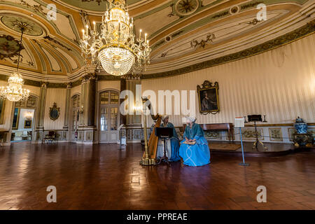 Queluz, Portugal - December 9, 2017: The Music Room, rich decorated of Queluz Royal Palace. Formerly used as the Summer residence by the Portuguese ro - Stock Photo