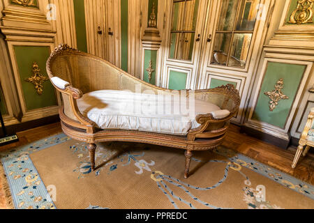 Queluz, Portugal - December 9, 2017: Divan inside of rich decorated Queluz Royal Palace. Formerly used as the Summer residence by the Portuguese royal - Stock Photo