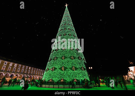 Christmas tree on Commerce square at night in Lisbon, Portugal - Stock Photo
