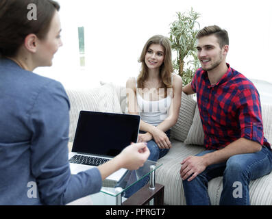 woman psychologist conducts a session with a young couple - Stock Photo
