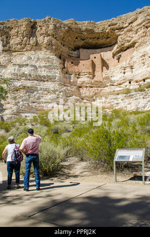 Visitors at Montezum's Castle pueblo ruins in northern Arizona, USA - Stock Photo