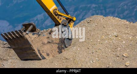 Arm and bucket of heavy duty construction vehicle - Stock Photo