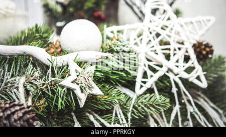 Decorative white Christmas New Year's toy stars hanging on Christmas tree close-up. White color. Winter Christmas New Year background. - Stock Photo