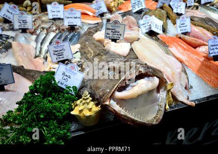 Whole monkfish (mouth open) on a fresh fish stall in Borough Market. London, England, UK. - Stock Photo