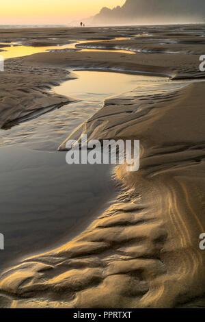 Manzanita, Oregon: Tide pools reflecting sunset sky, Manzanita beach - Stock Photo