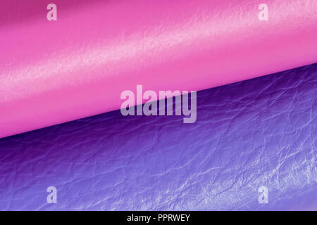 Two combining rolls of genuine leather with modern fashion shades, color companions, texture, selective focus - Stock Photo