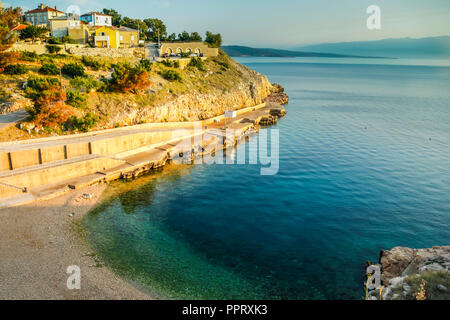 The waterfront view from the small Croatian village of Vrbnik on the island of Krk overlooking the Adriatic Sea - Stock Photo