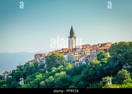 The sun sets on the hillside village of Vrbnik on the Croatian island of Krk, on the Adriatic Sea - Stock Photo
