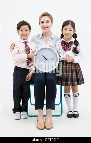 Children education. little boy and girl with native English-speaking teacher in white background 300 - Stock Photo