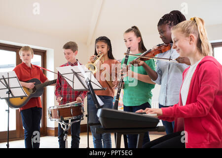 High School Students Playing In School Orchestra Together - Stock Photo