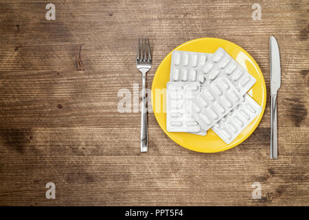 Pills ,drugs ,tablets,pharmaceutical on plate with fork and knife - Stock Photo