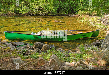Canoe on a Remote Lake Shore on Agnes Lake in Quetico Provincial Park in Ontario - Stock Photo