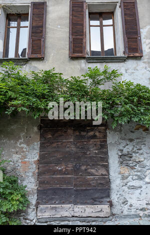 Image of a characteristic gate of an ancient village, vertical image - Stock Photo