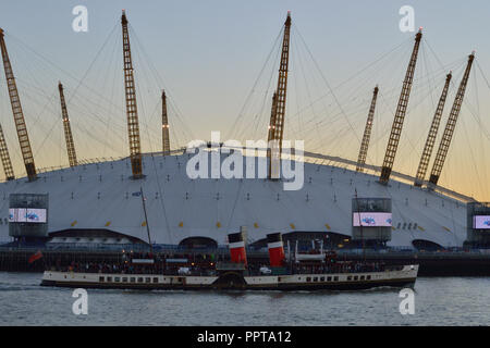 Historic Paddle Steamer 'Waverley' heads up the Thames to London passing the O2 - Stock Photo