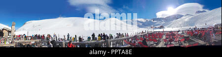 Paradiski, France - January 7, 2014: Ski resort bar and slopes aerial panorama, France, French Alps - Stock Photo