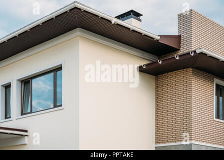 partial view of newly constructed building under cloudy sky - Stock Photo