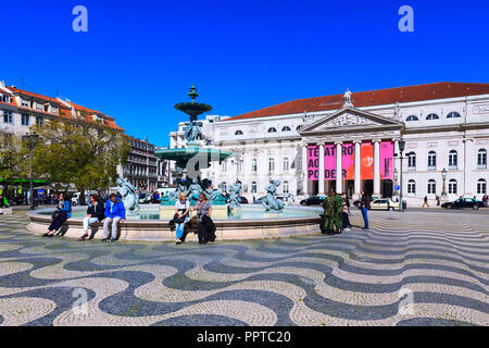 Lisbon, Portugal - March 27, 2018: Rossio square with fountain and people - Stock Photo