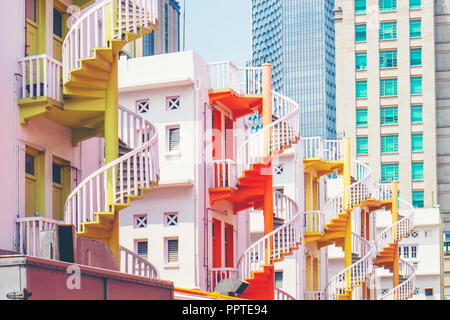 Colorful spiral staircases at the back of traditional Chinese shop houses in Bugis Village, Singapore. Colorful urban and cityscape concept - Stock Photo