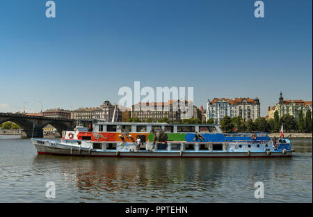 River sightseeing cruise boat on the River Vltava in the centre of Prague. - Stock Photo