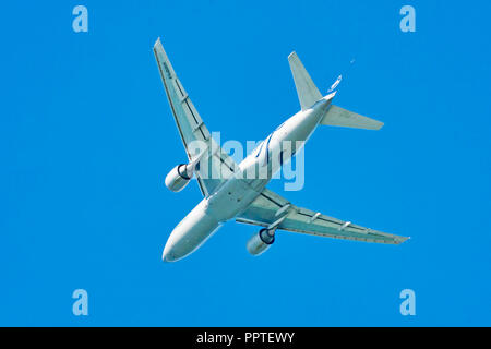 Fiumicino;Italy September 20; 2018 : A beautiful Alitalia airplane model Boeing 777-243(ER) take off from Fiumicino International Airport in a Rome s  - Stock Photo