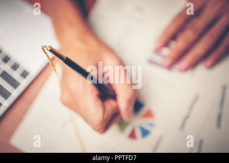 Business hands pointing and signing terms and agreement papers contract, signing concept - Stock Photo