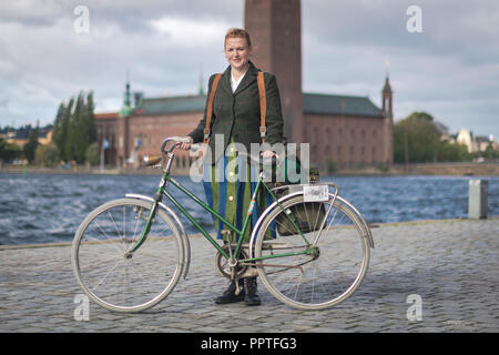 STOCKHOLM, SWEDEN, SEPT 22, 2018: Bike in tweed bicycle tour with vintage bikes and clothes. Before start with backdrop of city hall. - Stock Photo